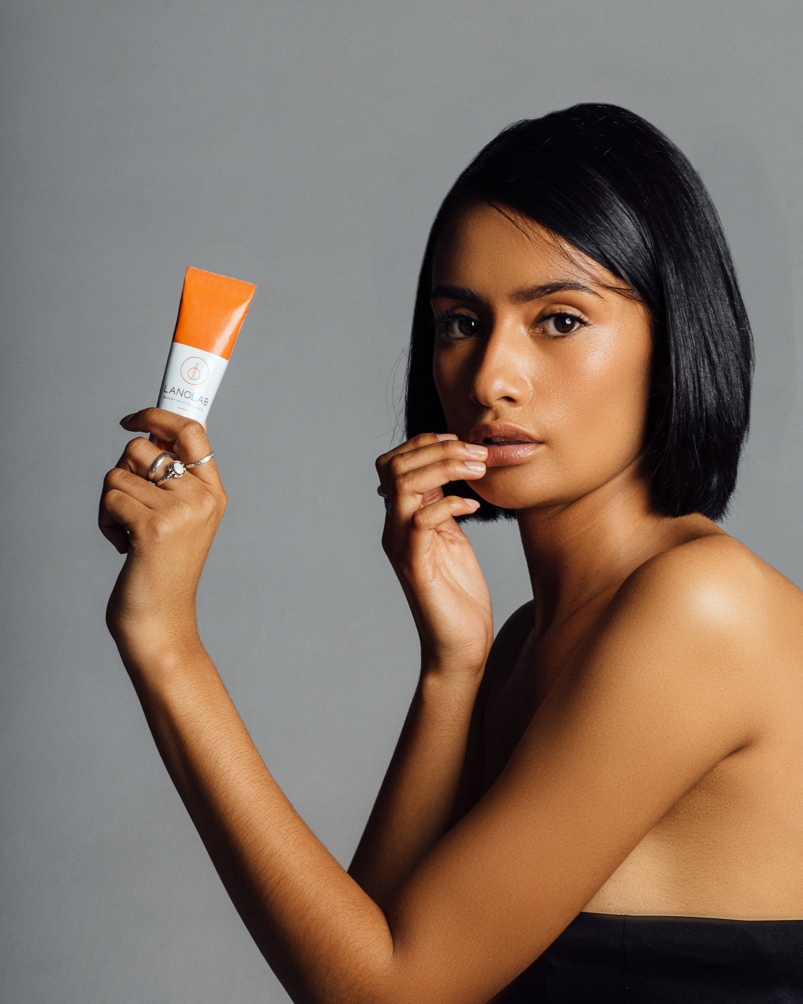 model with tube of balm