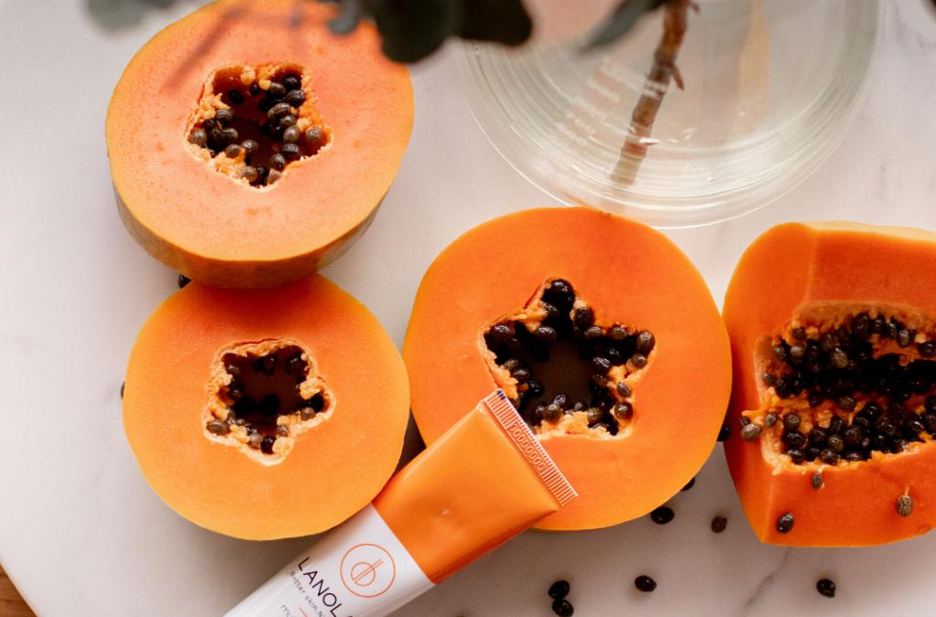 papaya-flat-lay -with -Lanolab-balm